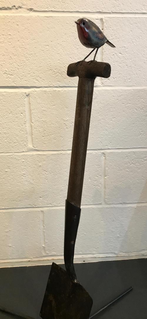 Robin on a spade