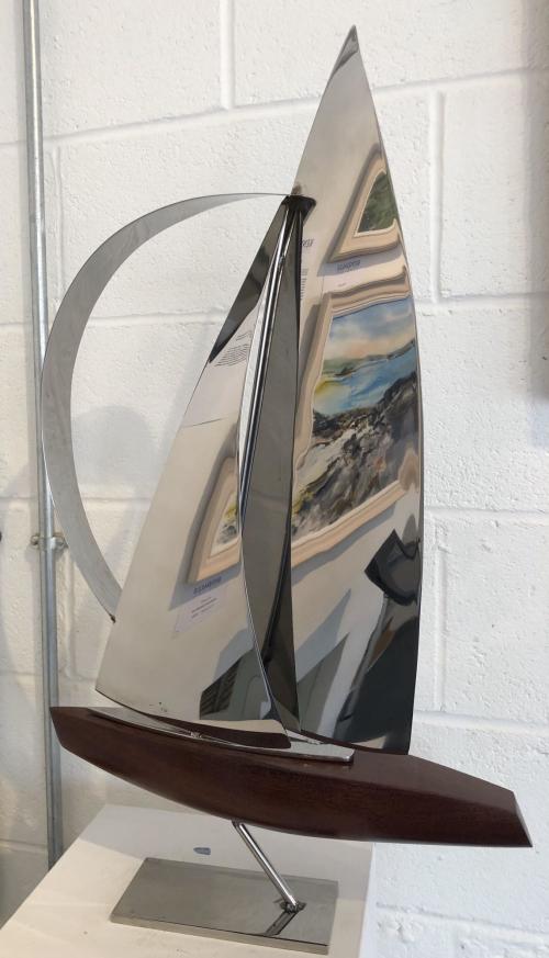 Large wooden hull yacht, narrow spinnaker