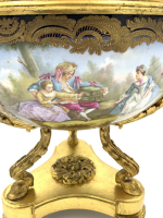 A fine 19th century sevres style porcelain blue-ground and gilt-metal mounted three-handled  pot pourri urn and cover