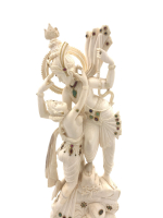 CARVED BEJEWELLED INDIAN IVORY STATUE OF EMBRACING LOVERS, RADHA AND KRISHNA, RAISED ON A WOODEN STAND