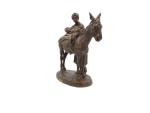A FRENCH PATINATED BRONZE GROUP OF A FIGURE AND DONKEY, ENTITLED 'ANIER DU CAIRE'