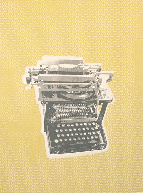 typewriter on yellow