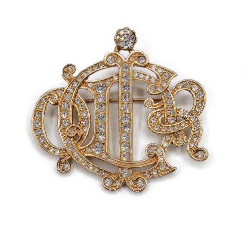 Dior golden logo with strass brooch