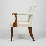 A reproduction of a Regency oak 'rope twist' carver armchair