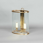 An oval glass wall lantern comprising 22 separate glazed panels inset to brass frame and backplate