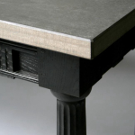 An ebonised reproduction side table