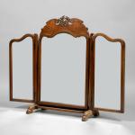 A Whytock and Reid walnut triptych dressing mirror