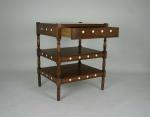 An oak three tier bedside table