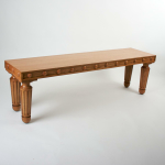 A reproduction oak regency style bench