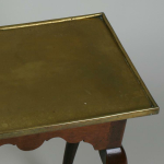 An 19th century brass top table