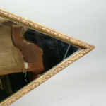 A gilt gesso diamond shaped mirror English circa 1860