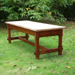 A large 19th century pine refectory table circa 1900 the rectangular top over two drawers chamfered and pegged supports united by cross stretchers
