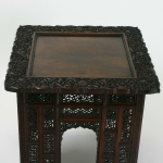 A 19th century carved square folding table
