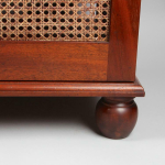 A mahogany cabinet for sitting a TV on top and housing audio visual equipment inside the back is open and inside has adjustable shelving