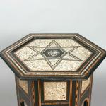 Large hexagonal ebonised ottoman occasional table inlaid