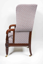 A Regency mahogany and upholstered wing armchair