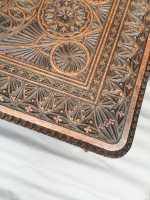 A 19th century Indian carved wood two tier centre table