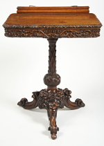19th century profusely carved oak reading table