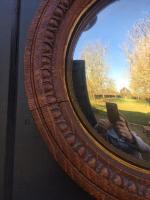 Pair of 19th century oak convex mirrors