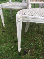 A set of 4 George III white painted side chairs by Francois Herve