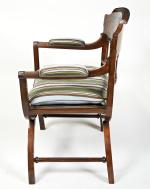 A mahogany X framed armchair