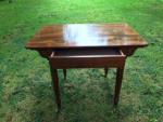 A mahogany Holland table