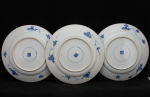 Set of three plates with flower baskets