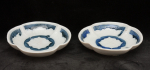 Pair of condiment dishes
